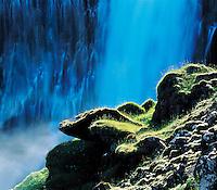 Mossy rocks near waterfall