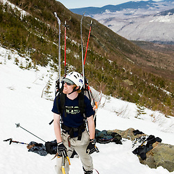 A man in King Ravine prepares to do some backcountry spring skiing.  King Ravine is a glacial cirque on the north side of Mount Adams in New Hampshire's White Mountains.