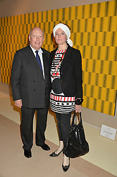 LORD FELLOWES and his wife LADY EMMA KITCHENER-FELLOWES at the private preview of Masterpiece 2015 held at the Royal Hospital Chelsea, London on 24th June 2015.