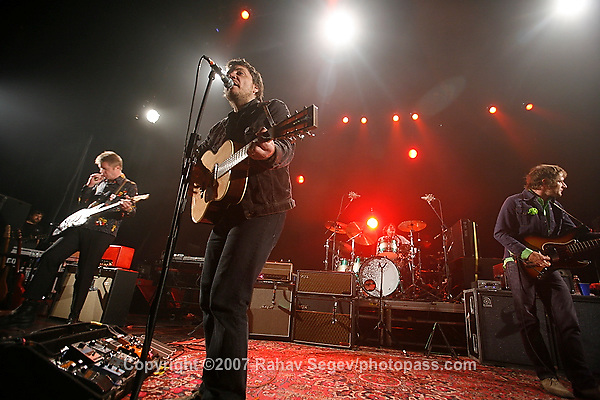 Wilco performing at The Hammerstein Ballroom on June 25, 2007. .Jeff Tweedy - Lead Vocals and guitar..Nels Cline - guitar and slide guitar..John Stirratt on bass.