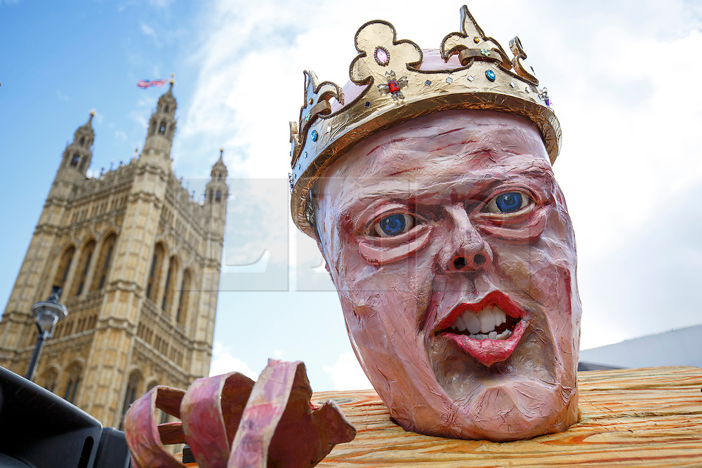 © Licensed to London News Pictures. 23/02/2015. LONDON, UK. A protester with Chris Grayling effigy marching to the parliament to mark Magna Carta's 800th anniversary and protest against the Global Law Summit and Chris Grayling, Justice Secretary in central London on Monday, 23 February 2015. Photo credit : Tolga Akmen/LNP
