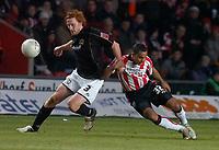 Photo: Alan Crowhurst.<br />Southampton v Milton Keynes Dons. The FA Cup.<br />07/01/2006. <br />Saints' Djamel Belmadi (R) with Nicky Rizzo.