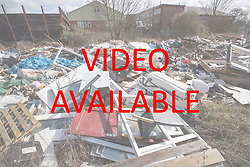 VIDEO AVAILABLE AT https://tinyurl.com/y85j5aua © Licensed to London News Pictures. 29/03/2018. London, UK. A large pile of waste and rubbish has been dumped in an area of scrap land next to houses and a recreation park in Edmonton, north London. Local residents are calling it a 'river of rubbish' and say it has been there for a month and are campaigning for it's removal.  Photo credit: Peter Macdiarmid/LNP