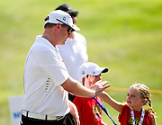 Matt Gifford high-fives a young fan during the 2012 Price Cutter Charity Championship at Highland Springs Country Club on August 9, 2012 in Springfield, Missouri. (David Welker/www.TurfImages.com).