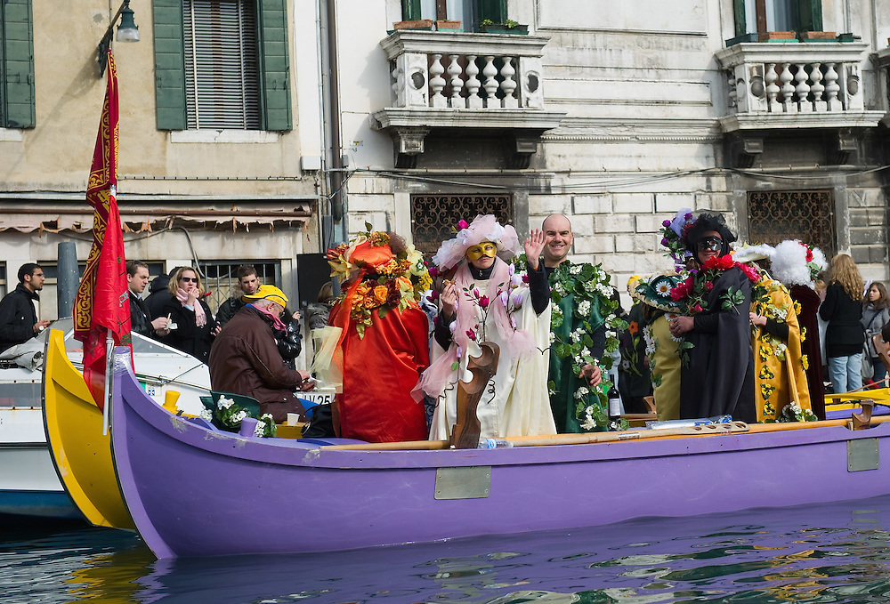 VENICE, ITALY - FEBRUARY 20:  A  rawing team in fancy dress poses for the camera along the Cannaregio Canal during the Venetian Feast on February 20, 2011 in Venice, Italy. During the Venetian Feast a traditional water parade sails from San Marco along the Canal Grande to the  district of Cannaregio where there the crowd waits for the Svolo della Pantegana (flight of the mouse).