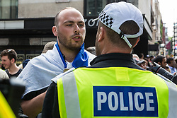 London, UK. 10th June, 2018. A police officer moves on a man dressed in an Israel flag before the pro-Palestinian Al Quds Day march through central London organised by the Islamic Human Rights Commission. An international event, it began in Iran in 1979. Quds is the Arabic name for Jerusalem.
