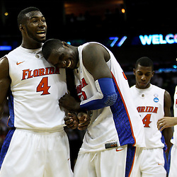 Mar 24, 2011; New Orleans, LA; Florida Gators forward/center Patric Young (4) and center Vernon Macklin (32) celebrate following a win over the Brigham Young Cougars during the semifinals of the southeast regional of the 2011 NCAA men's basketball tournament at New Orleans Arena. Florida defeated BYU 83-74.   Mandatory Credit: Derick E. Hingle