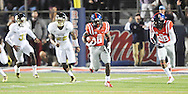 Ole Miss Rebels running back Jaylen Walton (6) ecores on a 91 yard run against Mississippi State at Vaught-Hemingway Stadium in Oxford, Miss. on Saturday, November 29, 2014. Ole Miss won 31-17.