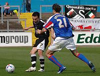 Carlisle's Zigor Aranalde and Swansea's Leon Britton.