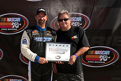 BAKERSFIELD, CA - MAY 24:  Greg Pursley driver of the #26 Gene Price Motorsports/Star Nursery/Real Water Ford wins the Coors Light Pole aware after qualifying for the NASCAR K&N Pro Series West Armed Forces 150 at the Kern County Raceway Park on May 24, 2014 in Bakersfield, California. (Photo by Jason O. Watson/Getty Images for NASCAR) *** Local Caption *** Greg Pursley