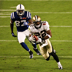 2010 February 07: New Orleans Saints cornerback Tracy Porter (22) runs back an interception for a touchdown as Indianapolis Colts wide receiver Reggie Wayne (87) pursues during a 31-17 win by the New Orleans Saints over the Indianapolis Colts in Super Bowl XLIV at Sun Life Stadium in Miami, Florida.