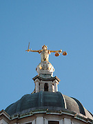Lady Justice on top of the Central Criminal Court in London, England.  Commonly known as the Old Bailey, this court building is the most famous in the country housing the Crown Court system.  The Crown Court sitting at the Central Criminal Court deals with major criminal cases from Greater London and, exceptionally, from other parts of England. It stands on the site of the medieval Newgate Gaol, on Old Bailey, a street which follows the line of the City's fortified wall (or bailey), and gives the court its popular name.