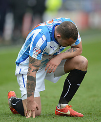 Huddersfield Town's Joel Lynch reacts - Photo mandatory by-line: Richard Martin-Roberts/JMP - Mobile: 07966 386802 - 21/03/2015 - SPORT - Football - Huddersfield - John Smith's Stadium - Huddersfield Town v Fulham - Sky Bet Championship