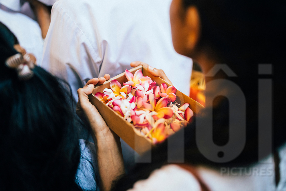 Crowds travel to the Temple of the Tooth to offer gifts and prayers on Poya Day, Kandy, Sri Lanka, Asia