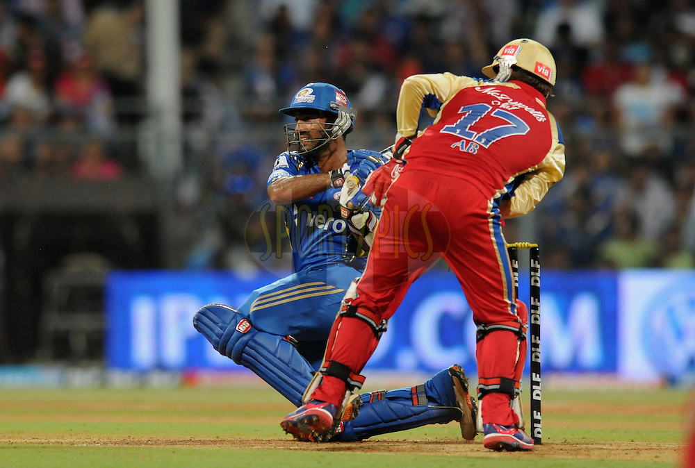 Dinesh Karthik of Mumbai Indians bats during match 54 of the Indian Premier League ( IPL) 2012  between The Mumbai Indians and the Royal Challengers Banglore held at the Wankhede Stadium in Mumbai on the 9th May 2012..Photo by Pal Pillai/IPL/SPORTZPICS.