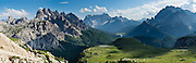 "The peaks of Cadini Group, Sorapiss Group, and Monte Cristallo rise (left to right) in the Dolomites, Veneto region, Italy, Europe. In the Cadini di Misurina, Cima Grande rises to 2999 meters (9839 feet), between Cima Piccola and Cima Ovest. Sorapiss and Monte Cristallo are in the Ampezzo Dolomites. The Cadini Group is in the Sesto Dolomites (Dolomiti di Sesto, or Sexten/Sextner/Sextener Dolomiten) which lie north of the Fiume Ansiei valley and Auronzo. From the Rifugio Auronzo toll road, hike for spectacular views around Tre Cime di Lavaredo (Italian for ""Three Peaks of Lavaredo,"" called Drei Zinnen or ""Three Merlons"" in German). The Dolomites are part of the Southern Limestone Alps. UNESCO honored the Dolomites as a natural World Heritage Site in 2009. Panorama stitched from 4 overlapping photos."