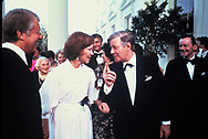 President Jimmy Carter and First Lady Rosalynn Carter  greet Chanceloor Helmut Schmidt at a state dinner fore NATO leaders  in June 1978<br /> Photo by Dennis Brack