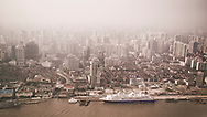 A view from the Oriental Pearl Tower of the Huangpu and Hongkou sides of Shanghai, China.  Air pollution, particularly from SO2 is a major problem in Shanghai.  Most of the pollution comes from coal-burning smoke and vehicle emissions.