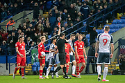 George Williams of MK Dons receives a red card during the EFL Sky Bet League 1 match between Bolton Wanderers and Milton Keynes Dons at the University of  Bolton Stadium, Bolton, England on 16 November 2019.