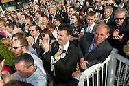 Crowds outside the winners enclosure cheering jockey Jason Maquire after he rode Ballabriggs to victory in the 2011 John Smith's Grand National.
