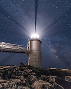The beams of light emanating from Marshall Point Lighthouse are caused by shadows where the panes of glass are framed. It's a beautiful spot to spend the night capturing the stars.