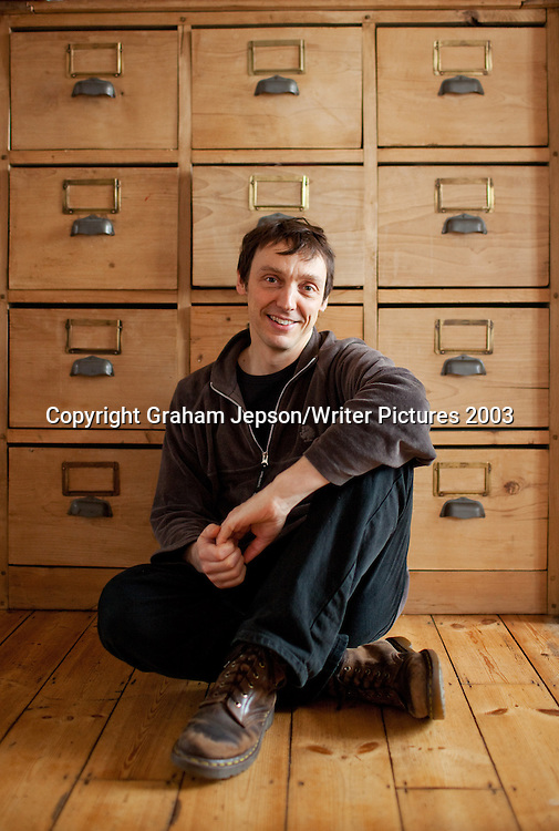 Philip Ball, science writer, photographed in his London home<br /> <br /> Picture Copyright Graham Jepson/Writer Pictures<br /> contact: +44 (0)20 8241 0039<br /> sales@writerpictures.com<br /> www.writerpictures.com