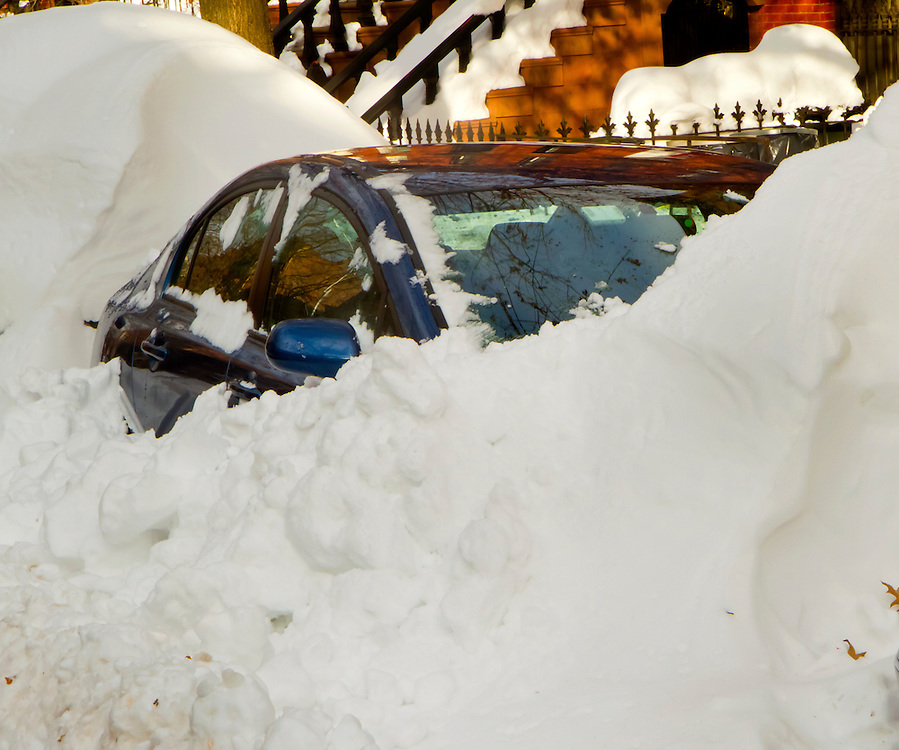 My car, buried  in over two feet of snow. December, 2009.It stood there for two weeks.