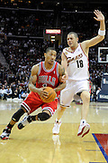 Apr 27, 2010; Cleveland, OH, USA; Chicago Bulls guard Derrick Rose (1) drives to the basket against Cleveland Cavaliers guard Anthony Parker (18) during the third period in game five in the first round of the 2010 NBA playoffs at Quicken Loans Arena.  Mandatory Credit: Jason Miller-US PRESSWIRE