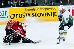 Mare Kumar vs goalie Ales Petrovcic during ice-hockey friendly match between legends of HDD Tilia Olimpija and HK Acroni Jesenice, on April 14, 2012 at SRC Stozice, Ljubljana, Slovenia. (Photo By Matic Klansek Velej / Sportida.com)
