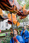 Puppeteers holding fish puppets representing creatures from the water. MayDay Parade and Festival. Minneapolis Minnesota USA
