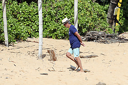 EXCLUSIVE: Pierce Brosnan takes a moment to meditate on the beach in Hawaii. 01 Apr 2020 Pictured: Pierce Brosnan. Photo credit: MEGA TheMegaAgency.com +1 888 505 6342