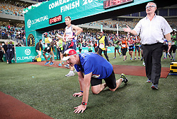 10062018 (Durban) an athlete pass the finnish line at the Mosses Mabhida stadium venue during the Comrades Marathon on Sunday as Bong'musa Mthembu and Ann Ashworth ensured that the coveted titles remained on these shores.<br /> Picture: Motshwari Mofokeng/African News Agency/ANA