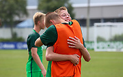 Slovenia defender Jamej Belinc is hugged by a teammate to celebrate their win over Canada during a CONCACAF boys under-15 championship soccer game, Saturday, August 10, 2019, in Bradenton, Fla. Slovenia defeated Canada in 2-1 in overtime and advanced to the finals against Portugal. (Kim Hukari/Image of Sport)