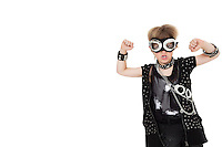 Front view of punk kid wearing pilot goggles with raised fist over white background