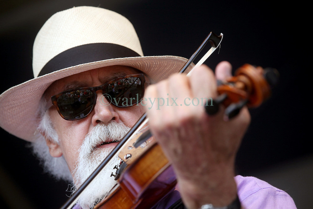 27 April 2012. New Orleans, Louisiana,  USA. .New Orleans Jazz and Heritage Festival. .Beausoleil's Michael Doucet plays fiddle on the Sheraton Fais-Do-Do stage..Photo; Charlie Varley.