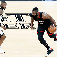 01 May 2017: San Antonio Spurs guard Jonathon Simmons (17) defends on Houston Rockets guard James Harden (13) during the Houston Rockets 126-99 victory over the San Antonio Spurs, in game 1 of the Western Conference Semi Finals, at the AT&T Center, San Antonio, Texas, USA.
