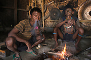 Konyak Naga opium smokers<br /> Konyak Naga headhunting Tribe<br /> Mon district<br /> Nagaland,  ne India