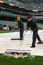 SAN FRANCISCO, CA - APRIL 09:  San Francisco Giants groundskeepers push water off the infield tarp during a rain shower before the game against the Los Angeles Dodgers at AT&T Park on April 9, 2016 in San Francisco, California. The Los Angeles Dodgers defeated the San Francisco Giants 3-2 in 10 innings. (Photo by Jason O. Watson/Getty Images) *** Local Caption ***