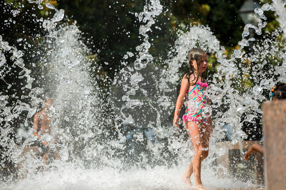 Children cool off in a public fountain at Waterfront Park as the southeast experiences a record setting heat wave June 22, 2015 in Charleston, South Carolina. Charleston has tied the historic record of 98-degrees (37 Celsius) and more hot weather is expected into next week.