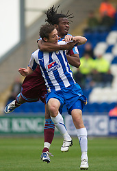 COLCHESTER, ENGLAND - Saturday, September 25, 2010: Tranmere Rovers' Ian Goodison strangles Colchester United's David Mooney to the ground during the League One match at the Colchester Community Stadium. (Photo by Gareth Davies/Propaganda)