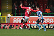 Swindon Town striker Fabien Robert and Coventry City midfielder John Fleck during the Sky Bet League 1 match between Swindon Town and Coventry City at the County Ground, Swindon, England on 24 October 2015. Photo by Jemma Phillips.