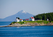 Point Retreat Lighthouse is situated at the northern tip of  Admiralty Island, which is bordered by Stephens Passage on the east and Chatham Strait on the west.  Inside Passage, summer, Alaska,