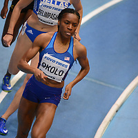Courtney Okolo competes in the women's 400m at the IAAF World Indoor Championships, March 2, 2018