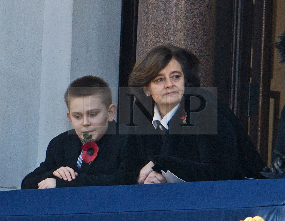 © London News Pictures. 11/11/2012. London, UK. Cherie Blair wife of former British Prime Minister Tony Blair with her son Leo Blair look on during the Remembrance Day Ceremony at the Cenotaph on November 13, 2011 in London, United Kingdom. Politicians and Royalty joined the rest of the county in honouring the war dead by gathering at the iconic memorial to lay wreaths and observe two minutes silence. Photo Credit: Ben Cawthra/LNP