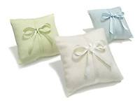 three cashmere pillows on white