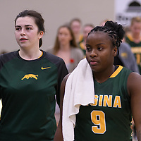 1st year guard Kyanna Giles (9) and 5th year forward Ainsley MacIntyre (10) head to the locker room at the half of their home game on November  5 at Centre for Kinesiology, Health and Sport. Credit: Arthur Ward/Arthur Images