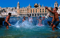MALTA VALETTA JUL00 - Local boys play ball in the water in the port of Marsa, Valetta...jre/Photo by Jiri Rezac..© Jiri Rezac 2000..Tel:   +44 (0) 7050 110 417.Email: info@jirirezac.com.Web:   www.jirirezac.com