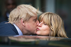 © Licensed to London News Pictures. 18/03/2018. London, UK. Foreign Secretary Boris Johnson (L) greets his sister Rachel Johnson (R) as he leaves BBC Broadcasting House after appearing on The Andrew Marr Show. Photo credit: Rob Pinney/LNP
