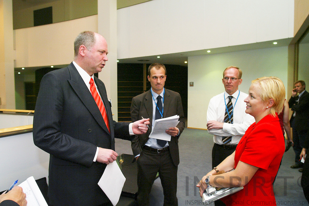 BRUSSELS -BELGIUM - 12 JULY 2006 -- From Left MEP Eero HEINNALUOMA, Finnish Minister of Finance, President-in-Office of the ECOFIN Council speaking with MEP Piia-Noora KAUPPI, and the Civil Servants from left Kajus HAGELSTAM and Martti ANTTINEN.  PHOTO: ERIK LUNTANG /