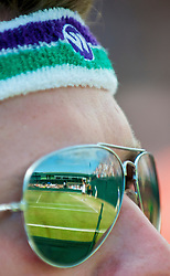 LONDON, ENGLAND - Wednesday, July 1, 2009: Laura Robson (GBR) reflected in the sunglasses of a tennis fan during the Girls' Singles 3rd Round match on day nine of the Wimbledon Lawn Tennis Championships at the All England Lawn Tennis and Croquet Club. (Pic by David Rawcliffe/Propaganda)